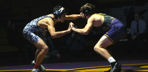 Wrestling opens season with a win