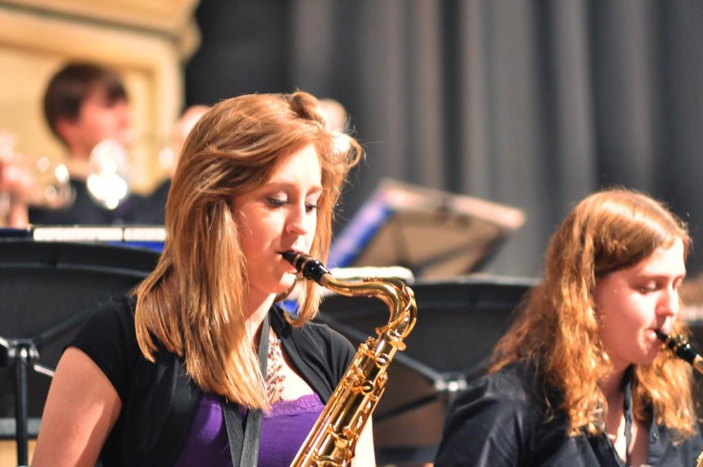 Junior Samantha Long and senior Leanna McAllister perform during Jazz Syndicate's set. While Long plays the alto sax normally in concert band, she takes up a tenor sax for jazz band.