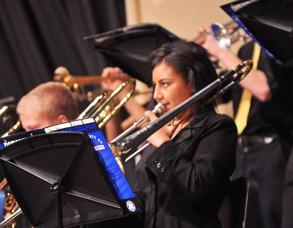 Jackie Anderson performs with the Jazz Band. Anderson plays the bass trombone, a lower version of the standard trombone.