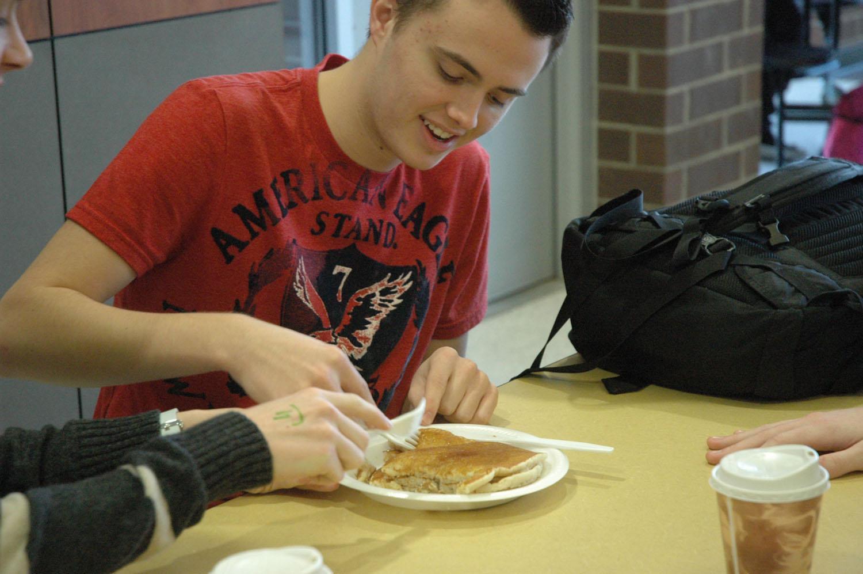 Sophomore Tyler Davis enjoys his pancakes during the Johnston's Big Give pancake breakfast. Pancakes were made by the Kiwanis club.