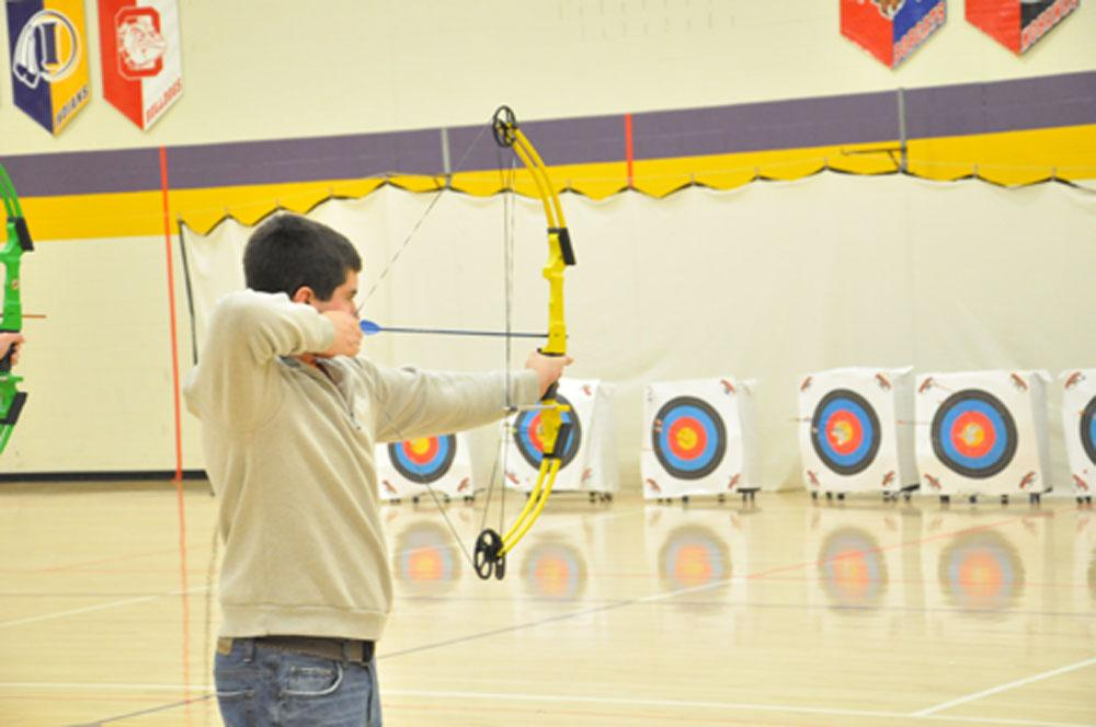 Andrew Evans draws his bow in the final lineup of the Archery season.