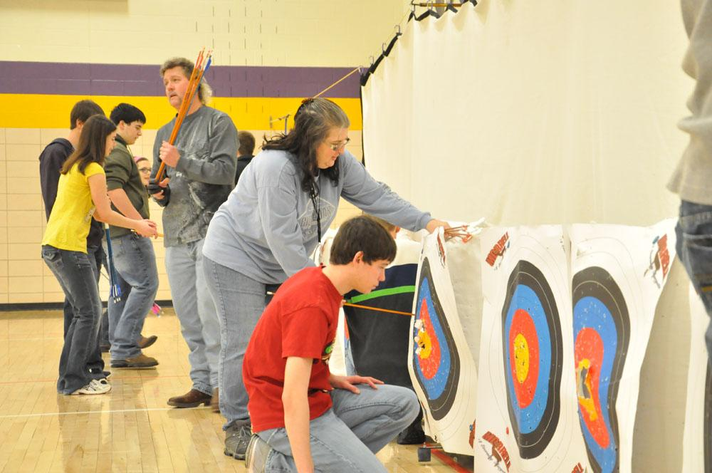 Austin Kain and co-coach Kathy Trail add up points on a previous shoot.