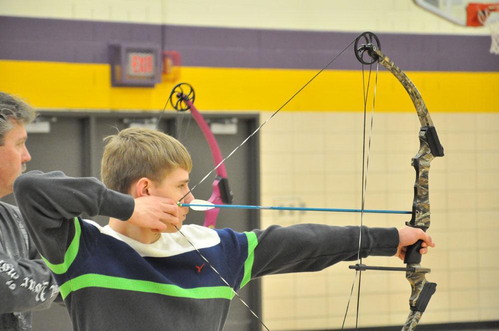 Justin Kain prepares to fire his last arrow.
