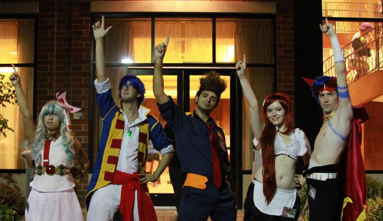 (From left to right) Anna Lam, Jesse Collins, Shawn Kendrick, Sofi Shannon, and Joeseph Swallow cosplay as a group of characters from Tengen Toppa Gurren Lagann at Anime Iowa in Iowa City. Anime Iowa took place at the Iowa City Marriott on July 27-29.