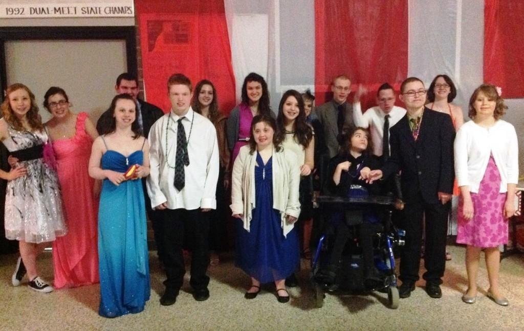Students+attending+Best+Buddies+prom+gather+for+a+group+picture.+The+prom+was+held+at+Dowling+High+School+on+Sat.+March+9.+%22Prom+was+fantastic+this+year%2C%22+Best+Buddies+president+Callie+Coulter+said.+%22The+theme+was+%22A+Night+at+the+Carnival%2C%22+so+there+was+dancing%2C+games%2C+and+carnival-themed+food.%22