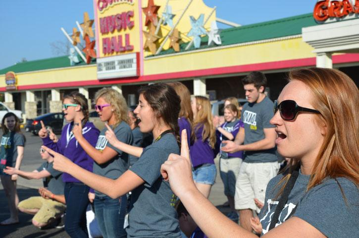 Students practice in front of Country Buffet in Branson on April 6.