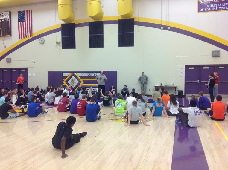 Students sit and listen to P.E teacher Brian Woodley. During March the students participated in several events such as team building activities and self defense lessons.