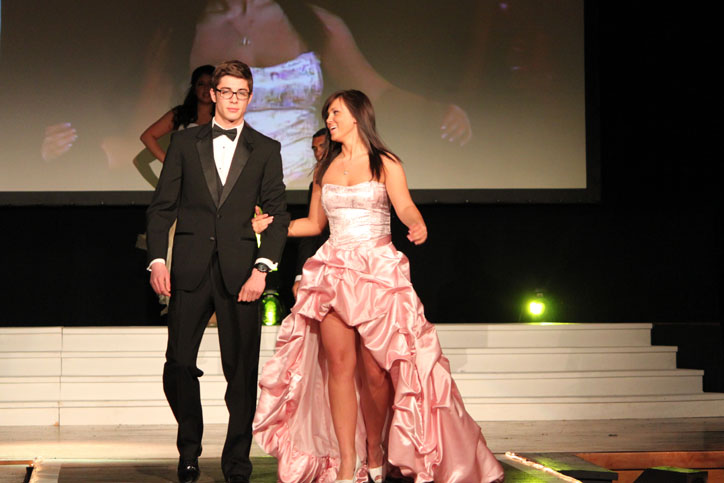 Urbandale senior, Armin Trepic and Johnston junior Aida Sarajlija walk down the runway of the Central Campus annual fashion show. Sarajlija is a fashion student and takes fashion classes at central campus in downtown Des. Moines. She wishes to pursue a fashion career after high school. Sarajlija made the dress in two weeks.