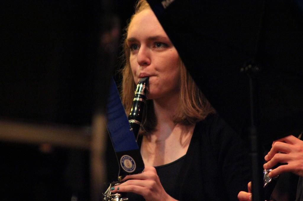 Junior Abby Dockum plays clarinet along with the wind symphony during their spring concert on May 7.