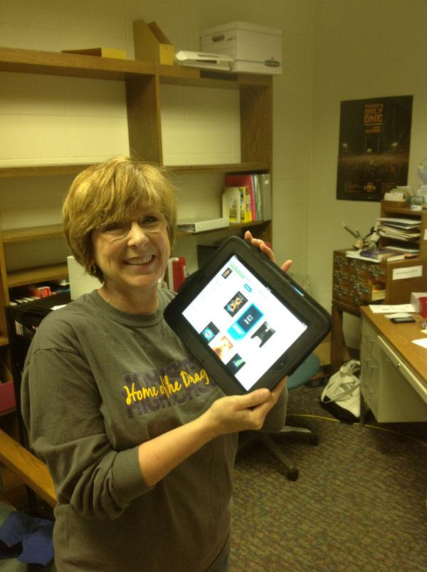 Jane+Behrens+showcases+the+Follett+app%2C+which+will+be+ready+for+students+when+the+iPads+roll+out+again+next+year.+