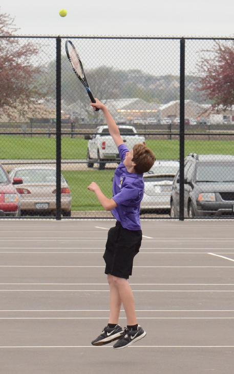 Sophomore Austin Probst attempts to return a ball from his opponents, blah and blah.