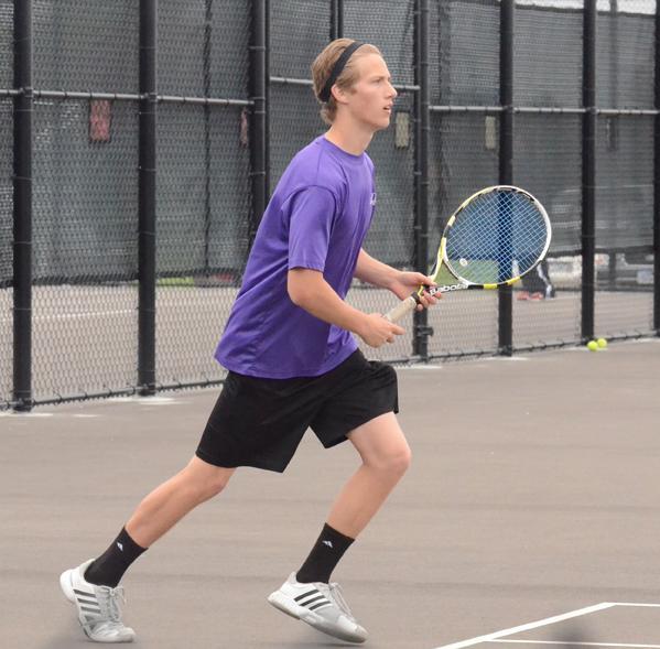 Senior Justin Atterberg runs towards the net to save ....