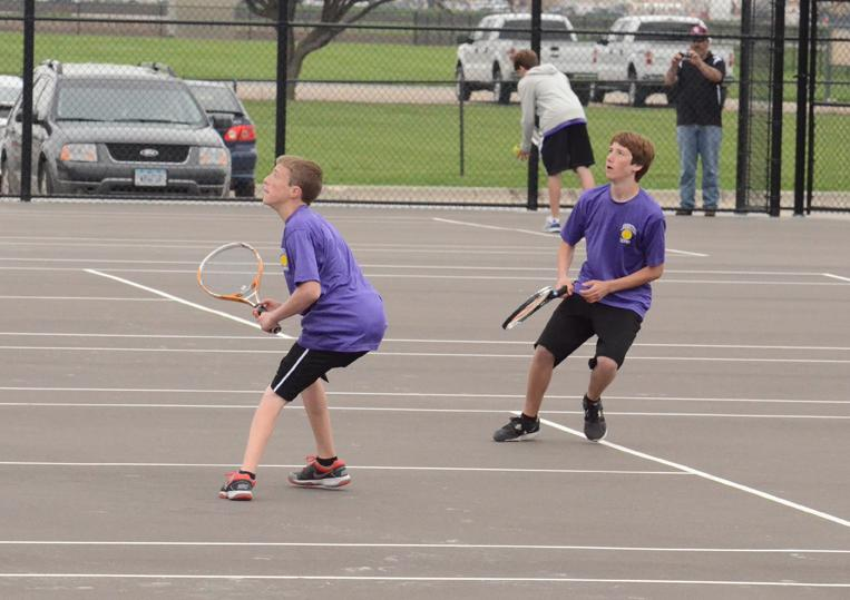 blah blah and Sophomore Austin Probst compete in a doubles match during the tennis districts.