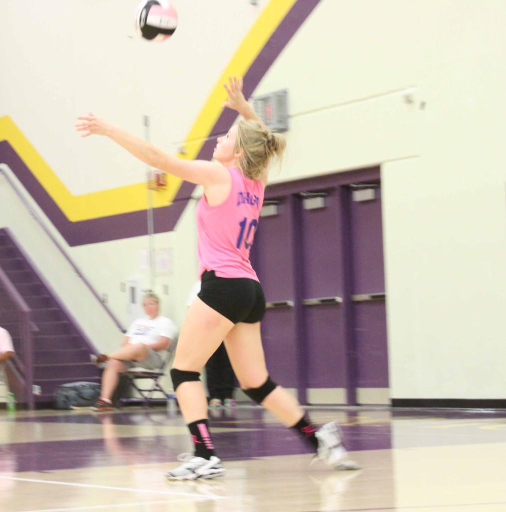 Senior Emily Hanson serves the ball during Dig Pink Spike Blue. Dig Pink Spike Blue is a match held annually by the Johnston volleyball team.