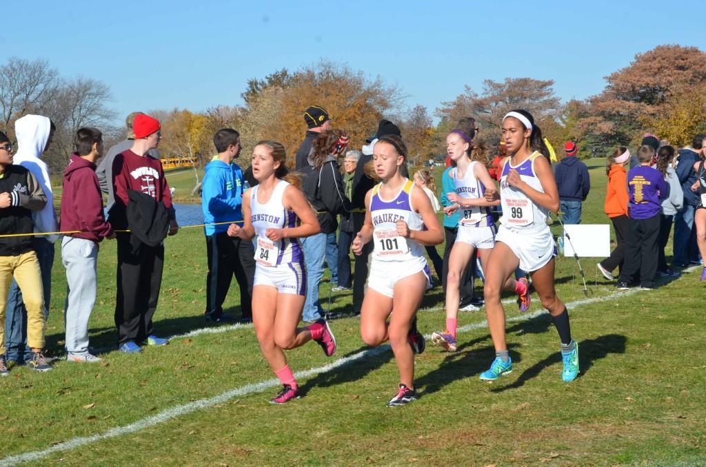 Juniors Maddy Bradley and Sara Ness pass two Waukee runners at the state meet last season.  Bradley placed 13th in 14:49.5 and Ness placed 18th in 14:54.8.