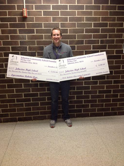 Industrial Technology teacher Nick Crosse holds both of his grants he received on Friday November 1st. The grants will pay for a VEX Robotics Classroom Expansion and Lynxmotion Robotic Arms to benefit the PLTW classes and TSA.
