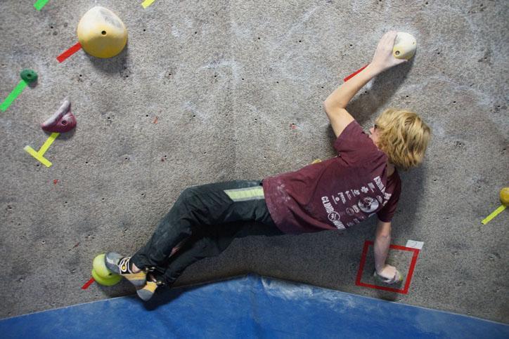 Zenor+tries+not+to+fall+onto+the+floor+from+the+very+bottom+of+the+wall.+Zenor+climbs+on+the+Climb+Iowa+Climbing+Team.