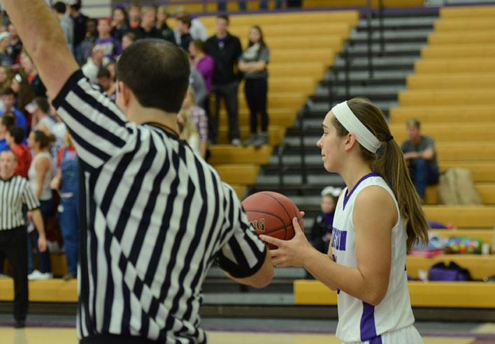Number 20, sophomore Haylee Towers receives the ball from a referee to pass to a teammate.