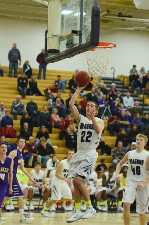 Number 22, junior Nick Neumann goes for a lay-up while number 40, junior Regen Siems waits to rebound the shot.