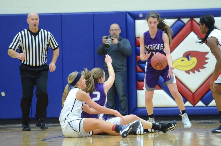 Junior Emily Lehman grabs the ball from a teammate. The varsity girls team won 52-20.