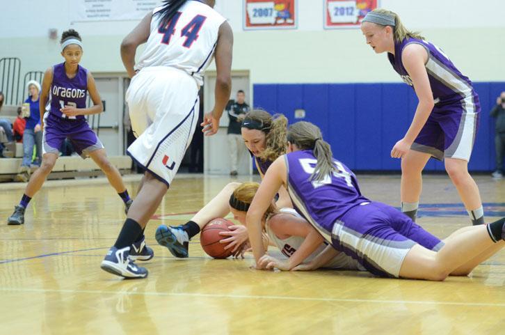 Dragons scramble for the ball. The varsity girls team won 52-20.