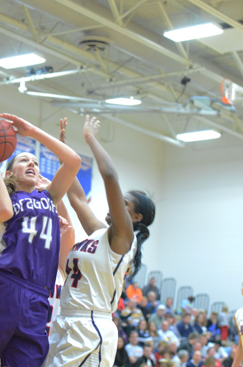 Freshman Taryn Knuth goes up for a lay-up against her Urbandale defender. The varsity girls team won 52-20.