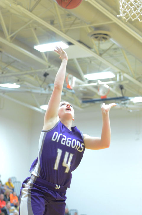 Sophomore Julia Beswick goes up for a lay-up against the Jayhawks. The varsity girls team won 52-20.