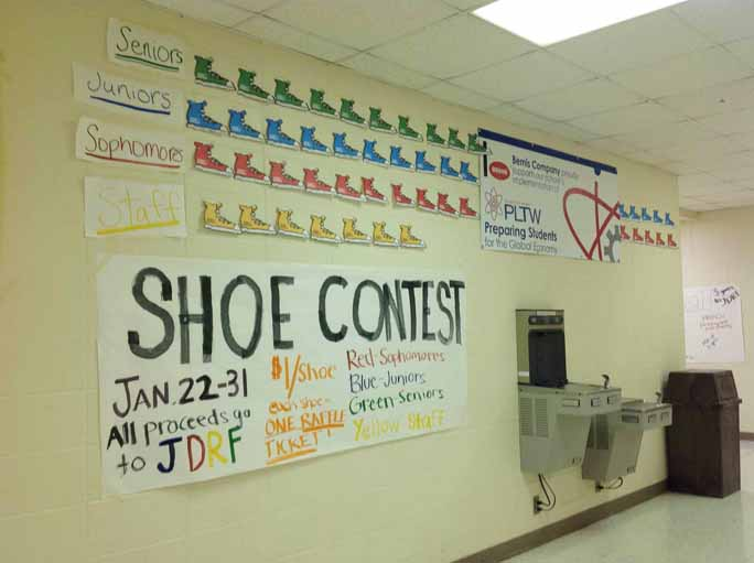 Shoes hang on the walls by the cafeteria after the first day of shoe sales for JDRF as a part of the Big Give.