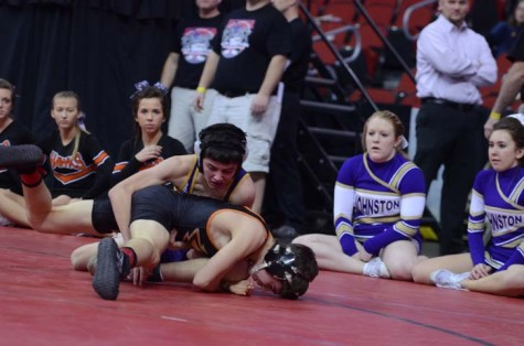 Sophomore Alec Ksiazek wrestles his opponent in the state tournament at Wells Fargo Arena.