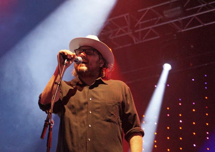 Standing alongside his band, lead singer Jeff Tweedy sings during the set full of alternative rock songs. Wilco performed on the main stage Friday July 10 at 9:15 pm.