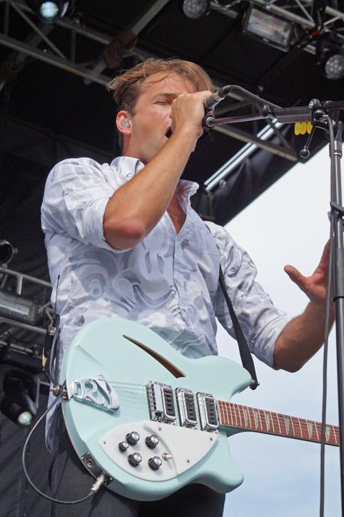 Taking a break from the guitar, lead singer Jean-Philip Grobler sings in front of the main stage audience. Grobler is originally from South Africa before he moved to Brooklyn continuing his music career.