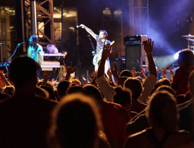 An enthusiastic crowd throws up their hands in response to Weezer's call and response during the performance. A few crowd members even decided to crowd surf periodically during the show Saturday July 11.