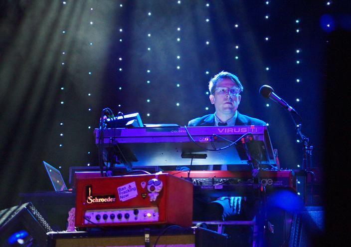 Pianist Mikael Jorgensen plays in front of the bands lit backdrop on the main stage Friday July 10. Wilco played songs off of their more recent albums and old as well, such as Humming Bird from the album A Ghost Is Born.