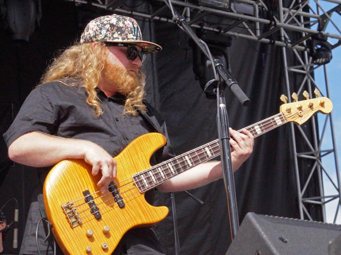 Bassist Erick Coomes strums his bass during their instrumental heavy set on Saturday July 11. Lettuce played on the main stage at 5 pm before Run the Jewels.