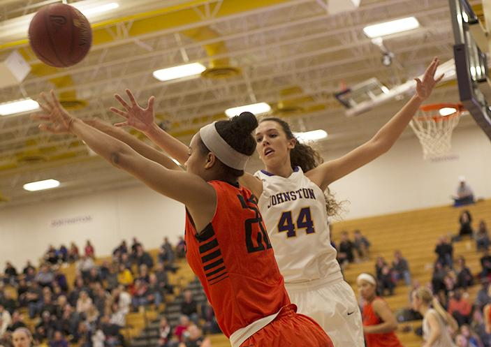 Taryn Knuth' 19 plays defense on an Ames opponent. Knuth set the school record for points scored by an individual in a game.