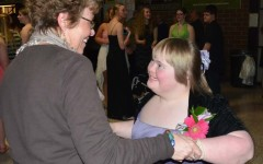 Sophomore Erin Gardner and her mom dance together at prom.