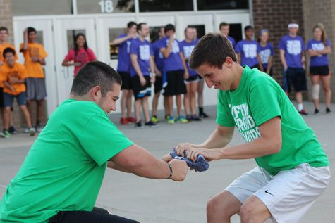 Seniors Tom Dusen and Nicholas Hanstad attempt to unroll a frozen T-shirt. The top three teams competed in the frozen T-shirt challenge.