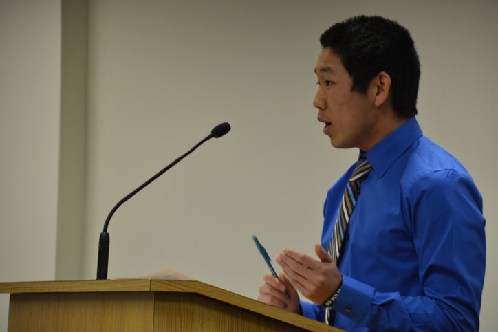 Marcus Miller speaks at a previous school board meeting regarding Student Council. Miller graduated from Johnston in 2015.