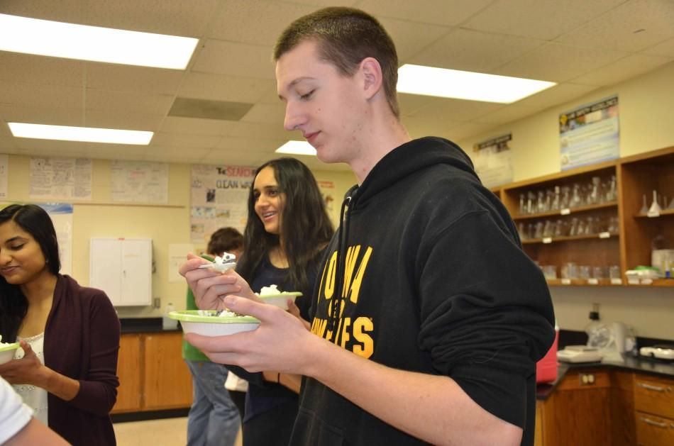 Junior Alec Kuehn tries the ice cream made in the lab.