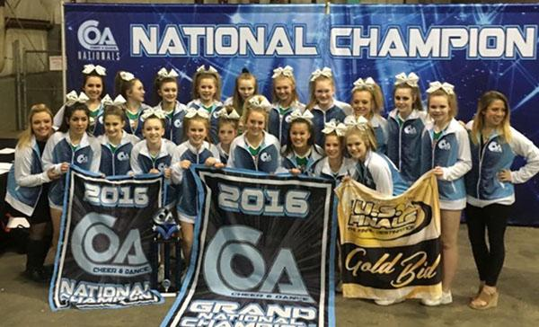 The Iowa Elite Cheer team posses for a picture after winning the titles of first place in small senior level three, national champions, grand champions, at a competition in Kansas City last season.