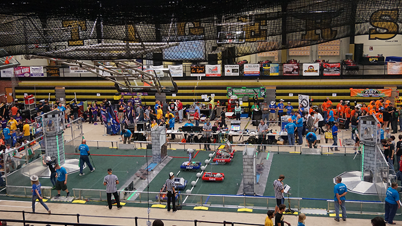 Six+teams+assemble+on+the+field+to+compete+in+a+match+at+the+CowTown+ThrowDown+Robotics+event.+These+teams+come+from+four+states+and+may+compete+with+each+other+at+other+events+during+the+year.
