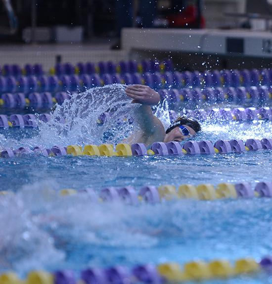 Freshman Grant Nelson competes in the 500 yard freestyle. The boys placed fifth overall at the state on Feb. 13.