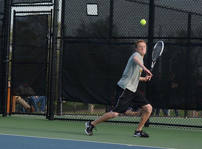 Senior Joel Heil gets ready to hit the ball in his doubles match against WDM Valley April 26. Heil and doubles partner, sophomore Jack Lucas won in two sets 6-3 and 6-7.