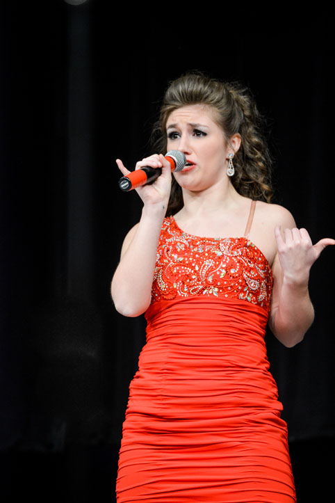 Senior Stephanie Graham preforms her solo at Southeast Polk Feb. 28.  Innovation won grand champion for the 5th time this season.