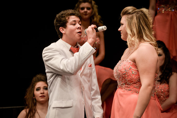 Senior Kameron DeMoss sings to senior Kennedy Kramer during the ballad at their competition at Southeast Polk Feb. 28.  Innovation won grand champion for the 5th time this season.