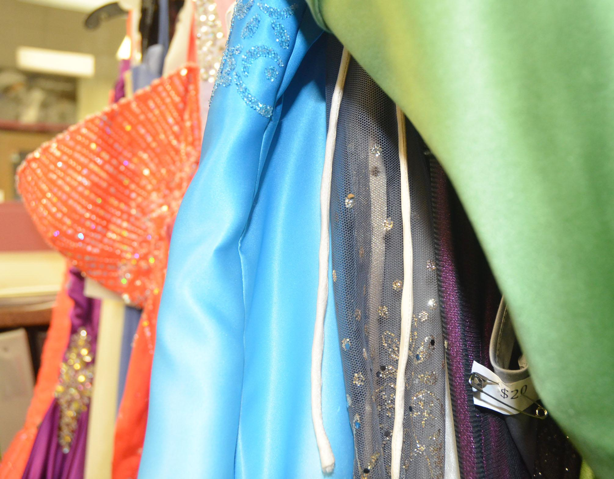 Prom dresses hang on two racks in the guidance office. The dresses will be on display until May 2.