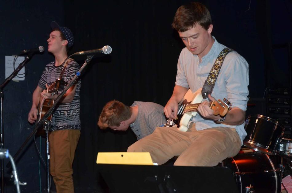 Sophomores+Grant+Ganzer+and+Joe+Thatcher+sing+and+play+guitar+during+their+set+April+25.+515+drummer%2C+junior+Shane+Burgess%2C+played+the+cajon.+The+group+opened+for+a+band+downtown+at+Vaudeville+Mews.