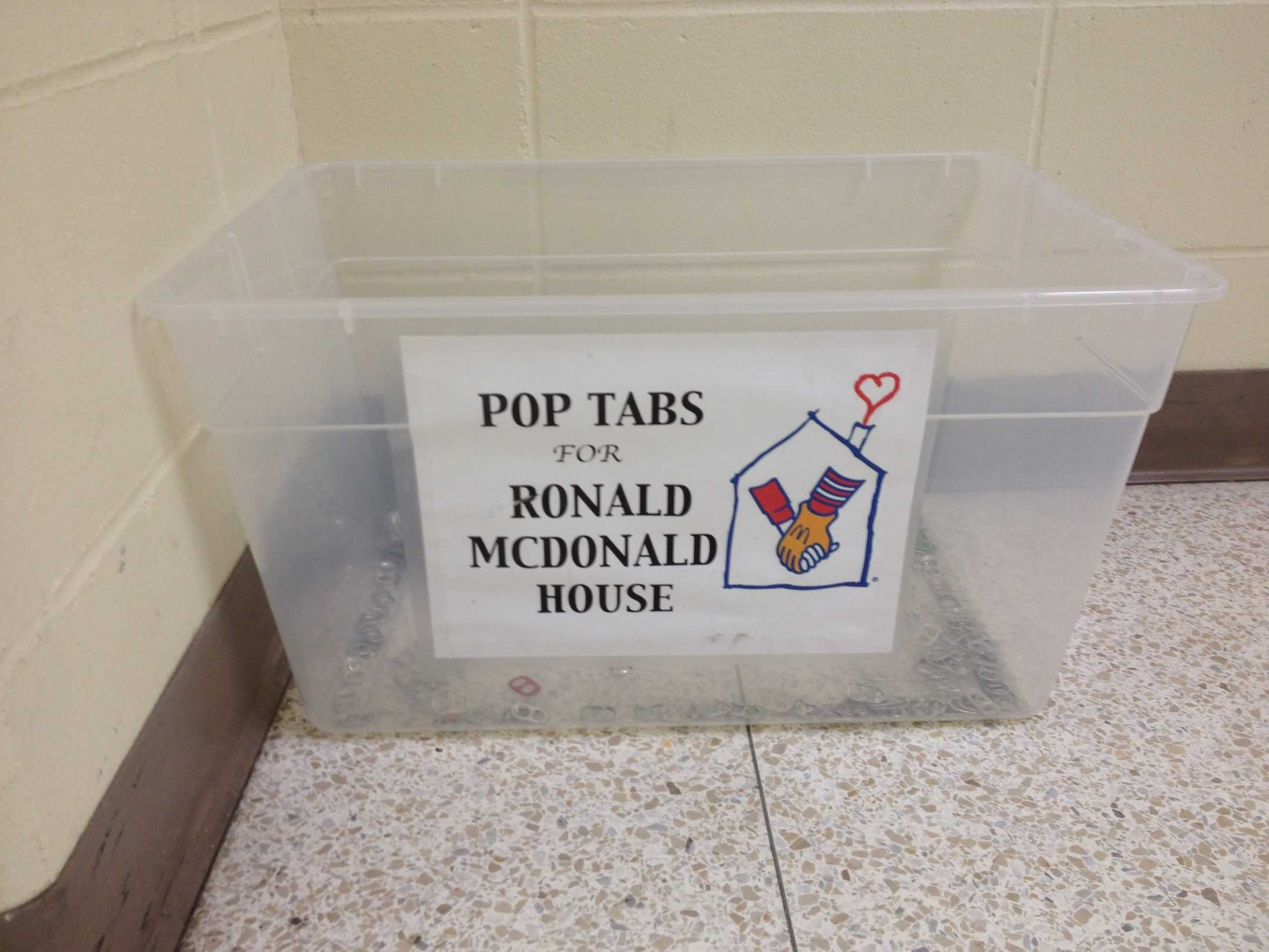 The pop tab bin that sits outside the lunchroom doors next to the glass case. Money for the recycled tabs is used to help fund the Ronald McDonald house and those staying within it.