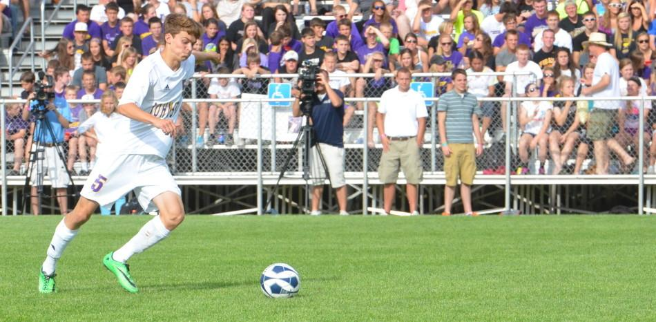 Junior Luke Johnson breaks away with the ball at his feet as he dribbles up the field in order to pass to senior and striker Sam Graving.