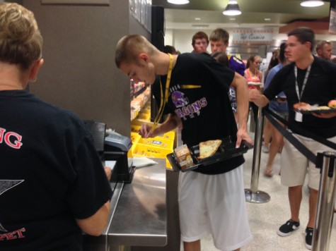 Senior Dustin Burg pays for lunch using his lanyard ID. Though it is easy for most students, some have had troubles scanning their cards due to the fading ink on the bar codes.